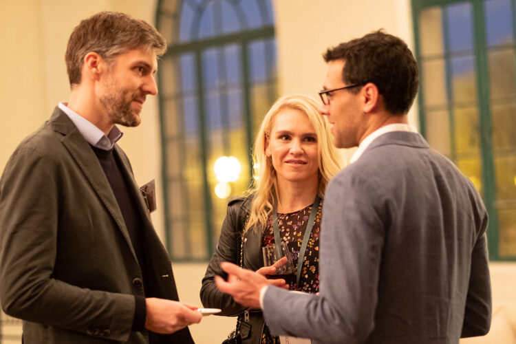 Three WashU alumni having a conversation
